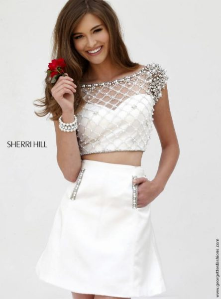 Be on trend in the crisp white crop top and skirt available at Georgette's